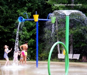 Kids playing at the water playground