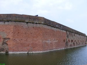 The breached wall and broken Confederate cannon at Fort Pulaski