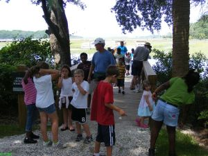 Kids on guided walk at Coastal Discovery Museum