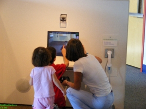 Family doing their portrait with the touch screen