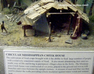 Native American mud and fiber house built on wooden poles