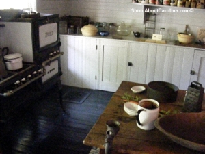 Old Kentucky Home 1900s kitchen table stove fridge