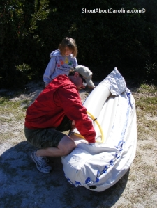Preparing our inflatable kayak to ride the Cherry Grove Inlet