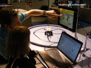 Kids manipulate robots through computers at Discover Place museum